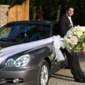 Bouquet, wedding car and groom